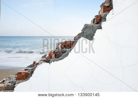Crack White Bricks Wall With Ocean Beach And Blue Sky