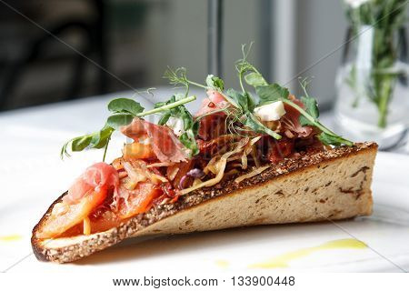 Delicious Cabbage appetizer with bacon on sour-sweet bread poster
