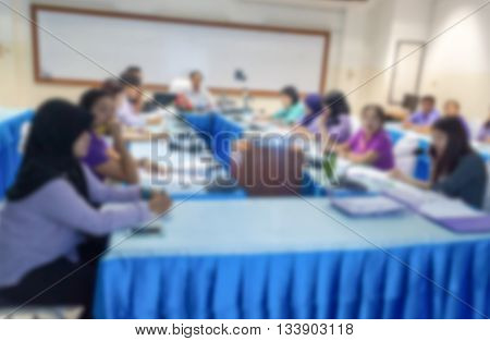 blurred abstract at Business education training conference hall or room seminar meeting People Analyzing Statistics Financial Concept with attendee background