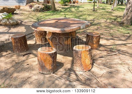 Tables and chairs in the garden,On a sunny shade trees.