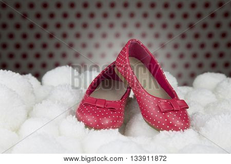 portrait of a pair of lacquered shoes for little girl