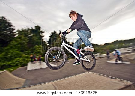 Joung Red Haired Boy Is Jumping With His Bmx Bike