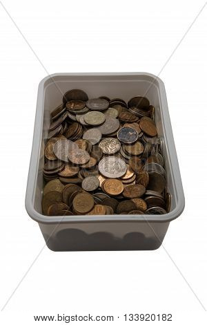 Light plastic box with unnecessary small coins on a white background.