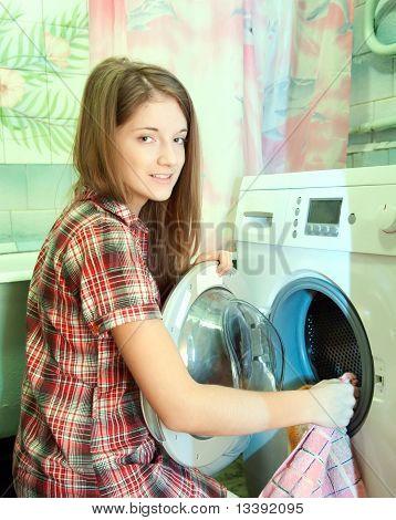 Teenager Girl Doing Laundry