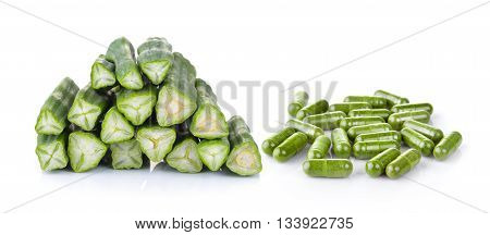moringa and Moringa capsules on white background