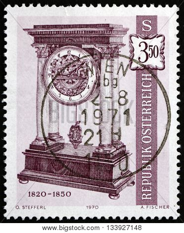 AUSTRIA - CIRCA 1970: a stamp printed in Austria shows French Column Clock 1820-50. Old Clock from Vienna Horological Museum circa 1970