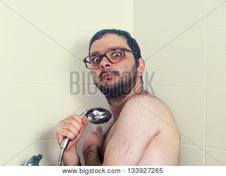 funny man caughted in shower close up