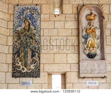 NAZARETH ISRAEL - MARCH 24: Panels depicting the Virgin Mary Basilica of the Annunciation in Nazareth Israel on March 24 2016