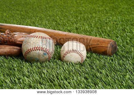 closeup soft ball and hardball on grass