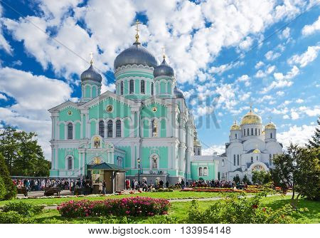 DIVEEVO RUSSIA - AUGUST 22 2015: Unidentified pilgrims go to Divine Liturgy at Trinity Cathedral and Saviour Transfiguration Cathedral of Holy Trinity Seraphim-Diveevo convent in village of Diveevo Russia
