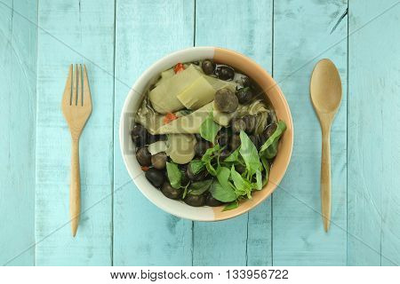 Curry Barometer Earthstars or hygroscopic earthstar of mushroom Vegetable in a bowl on green wooden background.