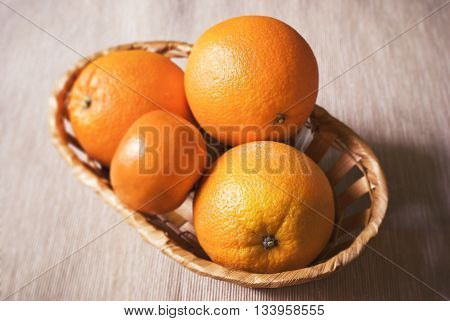ripe oranges in a basket. Healthy lifestyle.