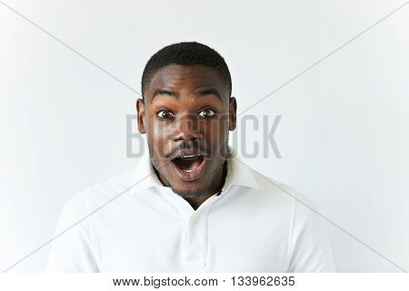 Portrait Of Excited African American Screaming And Looking At The Camera In Excitement, Surprised Wi