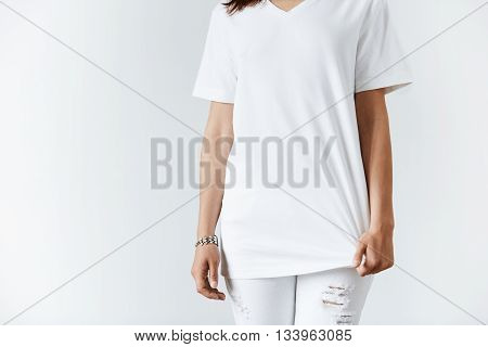 T-shirt Design Concept. Cropped Isolated Shot Of Young Brunette Casual Woman. Close Up Of Slim Stude