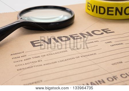 magnifying glass and evidence bag for crime scene investigation