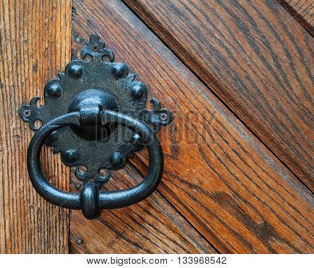 a antique doorknob on a wooden door. Close up