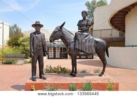 SCOTTSDALE, ARIZONA - JUNE 10, 2016: Winfield Scott Memorial. The sculpture depicts the founders of Scottsdale, Winfield Scott his mule ??Old Maud? and his wife Helen.