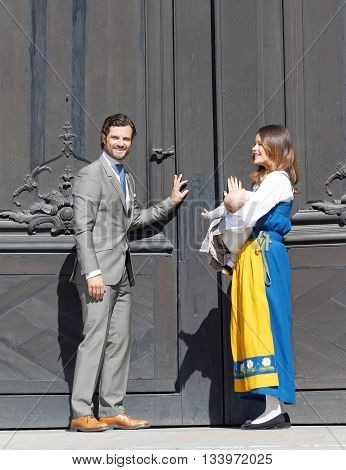 STOCKHOLM SWEDEN - JUN 06 2016: The swedish prince Carl Philip Bernadotte and princess Sofia Hellqvist and prince Alexander opening the door ito the royal castle during the swedish National day