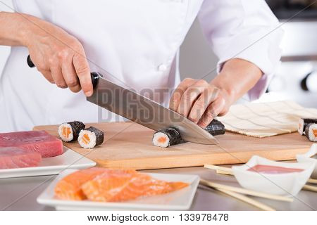 Chef preparing delicious sushi in a restaurant