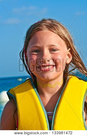 Young Girl At The Beach With Wet Hair
