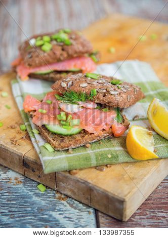Tasty sandwich with cereals bread and salmon