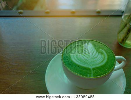 close up Hot green tea matcha latte in a cup;Latte art with Japanese green tea matcha