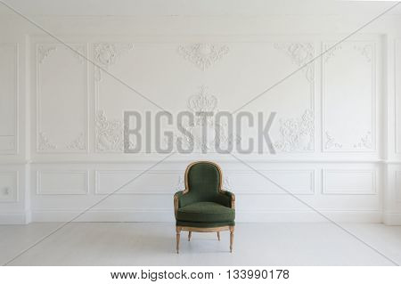 Antique green armchair fretwork wall on backround