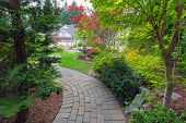 Garden brick paver path in frontyard with water fountain plants shrubs evergreen and deciduous trees landscaping poster