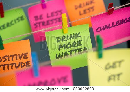 Drink More Water And Other Motivational Words For Healthy Lifestyle Written On Different Colors Stic