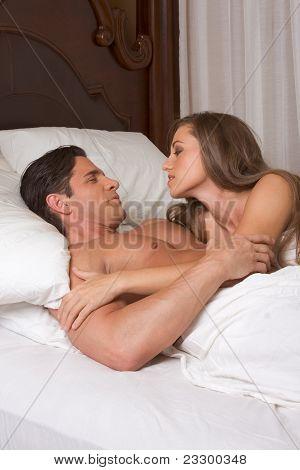 Young Heterosexual Couple In Bed