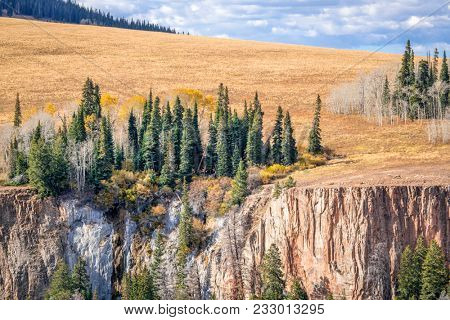 sandtsone cliff and aspen grove in fall colors - overlook of Deep Creek Canyon near Dotsero in Rocky Mountains, Colorado