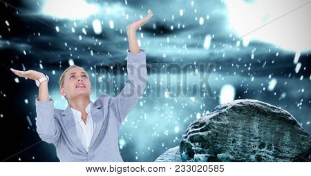 Digital composite of Businesswoman with arms raised against drops
