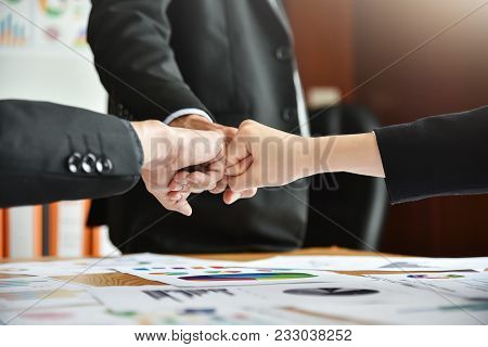 Business People Are Making A Fists Bump Together After Good Deal. Business Success And Teamwork Conc