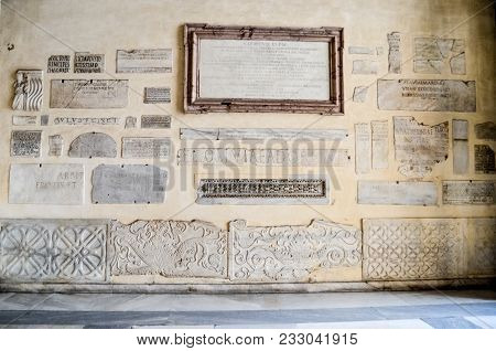 Rome, Italy - September 26, 2017: Marble Plaques With An Inscription In Latin On The Wall Of The Bas