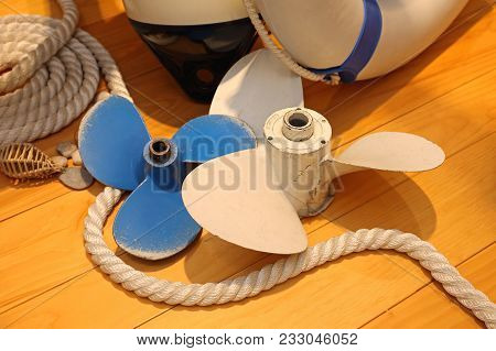 Two Used Propellers For Boat At Deck
