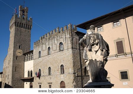Medieval buildings in Arezzo (Tuscany Italy) with statue made in 1595. poster