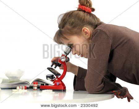 Girl And Microscope