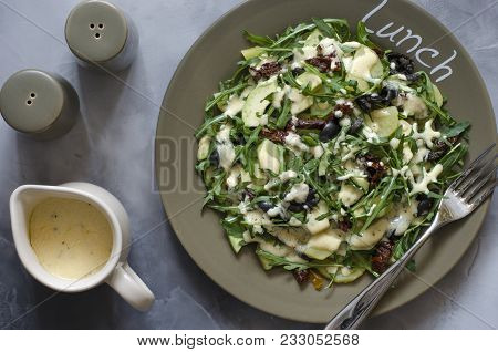 Salad With Potatoes With Olives And Sun Dried Tomatoes With Arugula And Avocado
