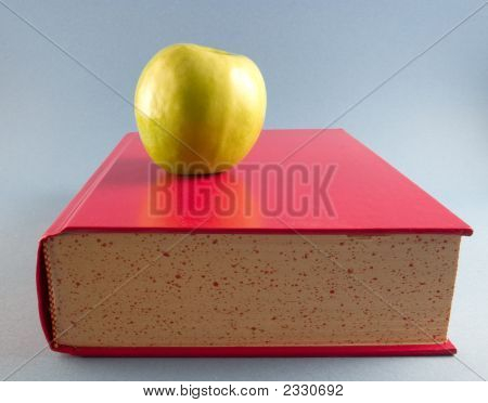 Yellow Apple With Red Book