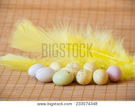 Perfect Colorful Sweets Easter Eggs And Feather On Wooden Background