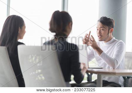 Serious Businessman During Job Interview.job Interview Concept.businessman Explaining And Listen To