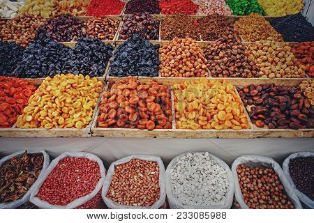 Dried Fruits And Nuts On Food Market, Boxes With Colorful Various Assortment Of Vegetarian Healthy D
