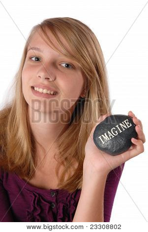 Teenage Girl Holding Rock With Word Imagine