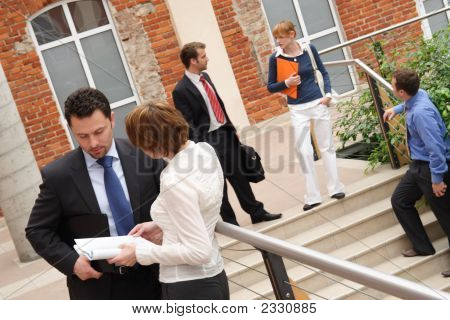 five people dressed in business and casual business attire in various activities. poster