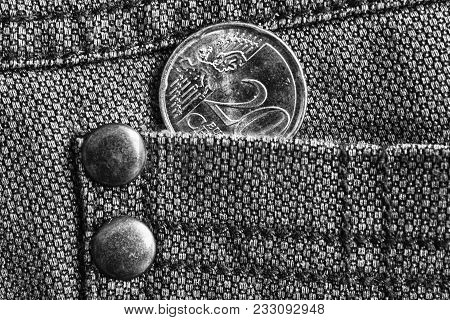 Euro Coin With A Denomination Of Twenty Euro Cents In The Pocket Of Denim Jeans, Monochrome Shot.