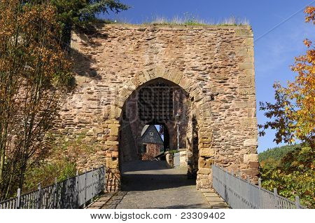 Stone gate with a portcullis