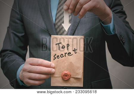 Top Secret Documents Presentation Concept. Top Secret Message In Detective Spy Agent Hands. Confiden