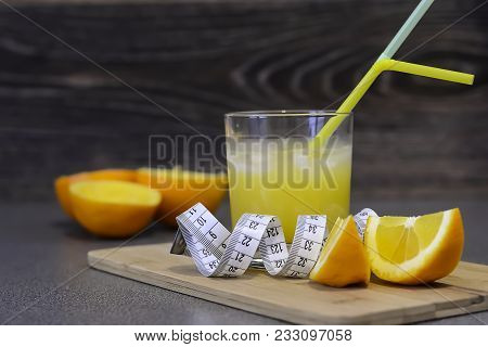 Cut Oranges Lying On A Wooden Table .