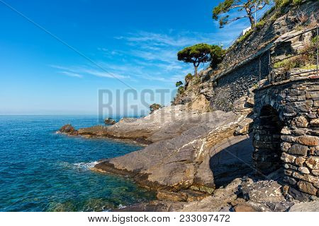 View of Mediterranean sea an rocks along coastline of Recco - small town in Liguria, Italy.