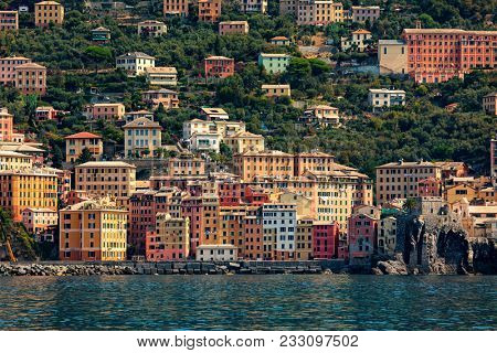 Seaside view of colorful houses of Camogli - small town on Mediterranean sea in Liguria, Italy.